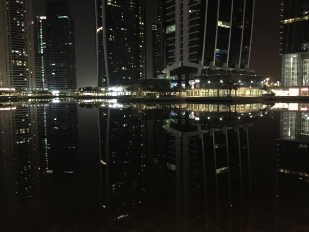 ashusPhotography-Jumeriah Lake Towers (JLT, Dubai) buildings reflection in the lake, captured in the night.